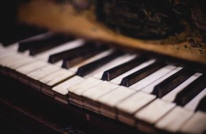 Old piano with damaged keys
