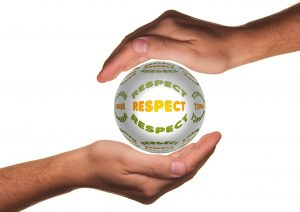"Two hands holding a globe with the words ""respect "" written all over it"