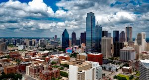 Dallas cityscape on a cloudy day - see the beauty of moving to Dallas first-hand.