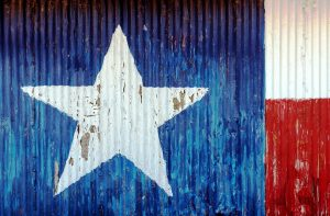 The flag of Texas painted on a door.