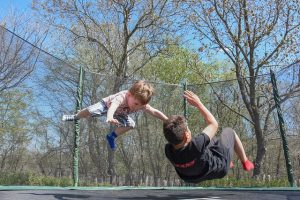 Kids playing on a trampoline - one of many family-friendly activities in New Braunfels.