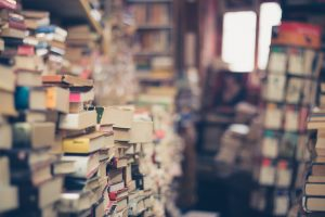 Packing tips for long distance relocation- piles of books