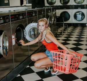 A girl in a laundromat