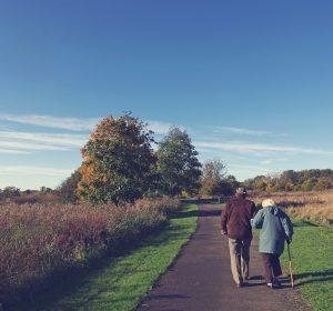 an elderly couple walking