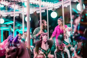 people riding a carousell