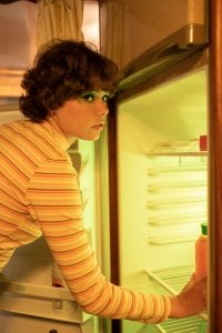 -woman cleaning the refrigerator
