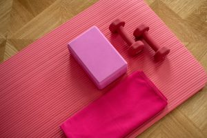 pink dumbbells to pack when relocating sports equipment to a new home
