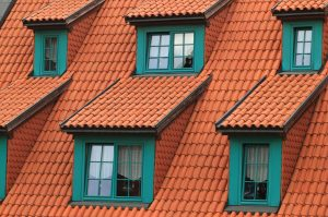 orange roof with green windows