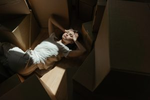 a woman lying on the boxes