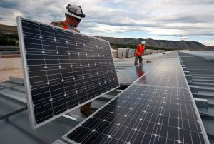 workers installing panels so you can enjoy all the benefits of going solar in Texas