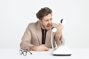 A man arguing on the phone