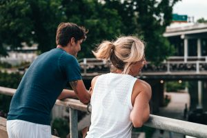 man and woman standing on the bridge