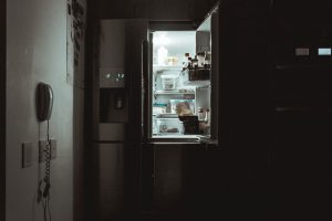 Packing your fridge for moving with the open doors in the dark