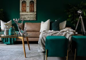two green sofas