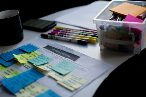 Moving your entire household to Seguin with plan made with paper and sticky notes