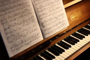 music sheets on the piano
