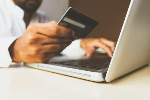 man paying with a credit card online