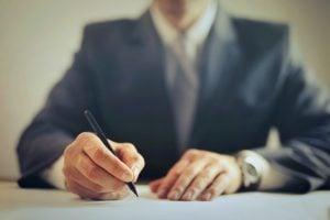 man signing a bill of lading