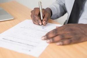 man signing bill of lading