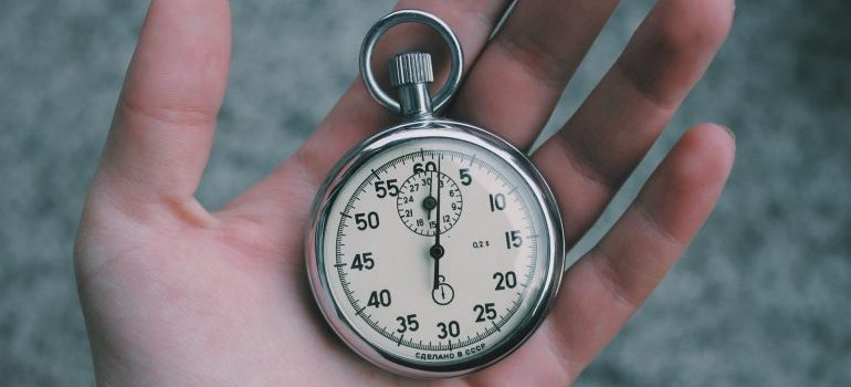 A clock in a person's hand