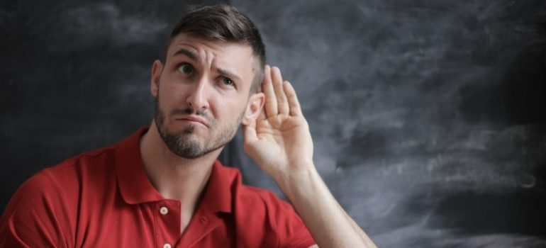 man listening to what movers have to say is successful in avoiding conflicts with movers