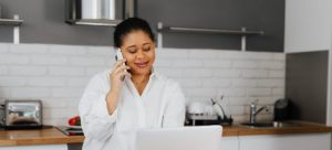 A woman using over-the-phone estimates instead of an in-home moving estimates.