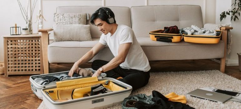 A guy listening to music during packing