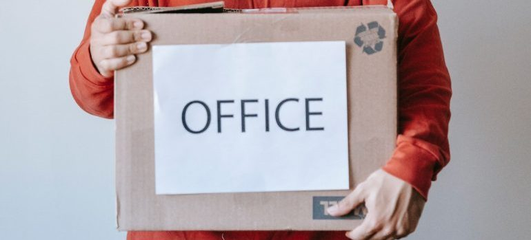 Marked box, with office inventory in it.