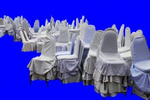 Chairs wrapped in protective covers that will protect them during transport.